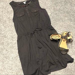 Black sleeveless dress and necklace